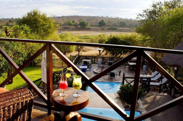 Enjoy cocktails on the Crocodile Kruger Safari Lodge deck.