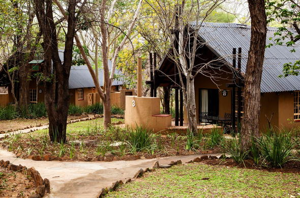 Exterior of the chalets offered at Protea Hotel Kruger Gate.