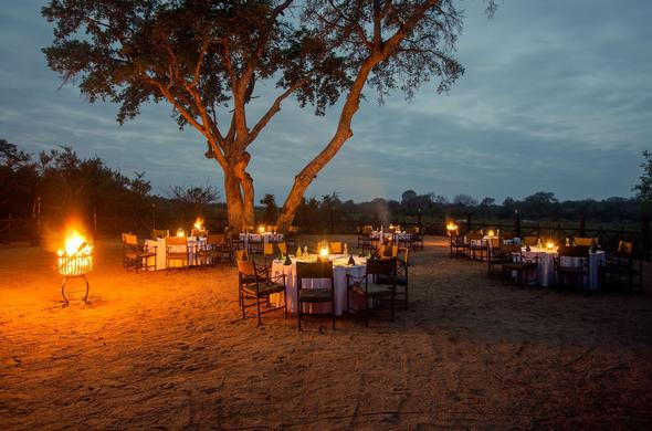 Dine outdoors under the open African skies.