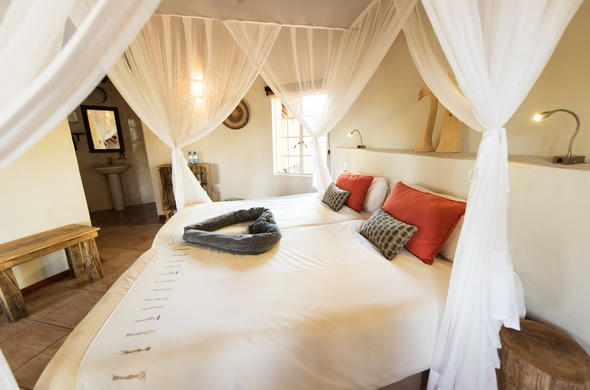 Comfortable en-suite accommodation offered at Sefapane River Lodge.