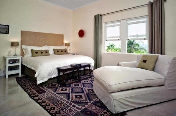 Umsisi House accommodates guests in lovely bedrooms.